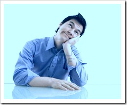 3569354-young-asian-business-man-sitting-daydreaming